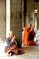Old lady praying with Monk