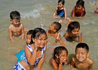 Kids in the water at Nai Yung
