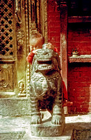 Kid with Chinese statue