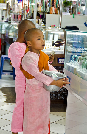 Young girl monk collecting alms in Bogyoke market