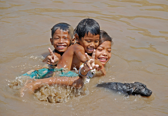 Kids in the Muddy Tonle Sap River